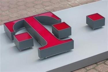 T-Mobile logo is ready to be placed on a former Era Mobile outlet in Warsaw